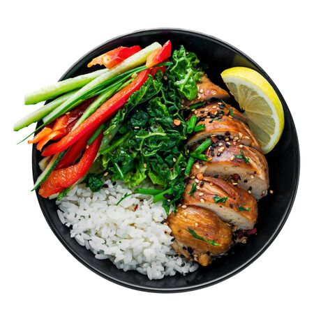 Delicious Buddha bowl with teriyaki chicken, fresh vegetables and basmati rice isolated on white background. Top view, directly above shot. Stock Photo