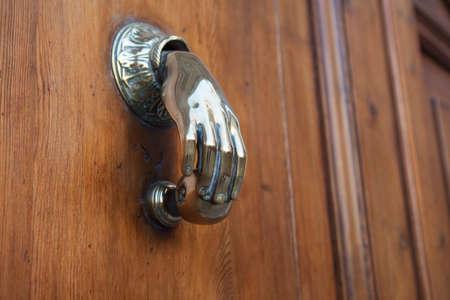 reloaded: Metal knocker on wooden door Stock Photo
