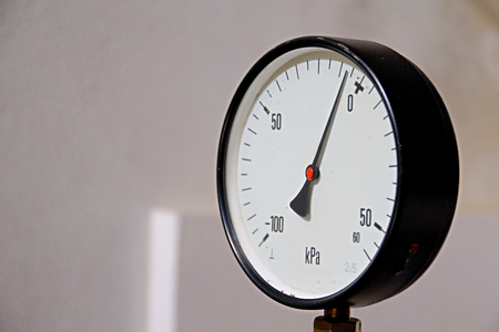 Photo shows industry meter with numbers and white background. photo