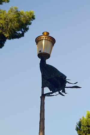 Photo shows details of city street lamp with rag. photo