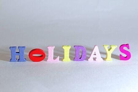 holidays sign on white background. photo
