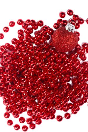 christmas beads: Photo shows a closeup of red Christmas beads and ornament on a white background.
