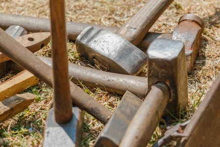 medieval blacksmith: Photo shows close-up of medieval metal smith hammers during a day. Stock Photo