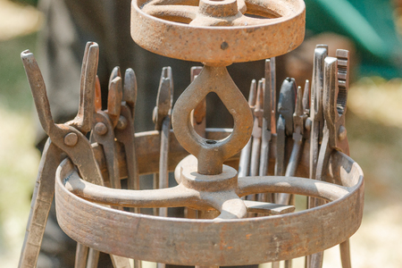 medieval blacksmith: Photo shows detail of various of medieval metal smith instruments during a day.