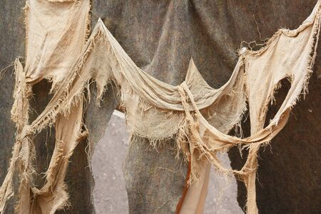 historical events: Photo shows close-up of medieval rags waving on the wall during a day.