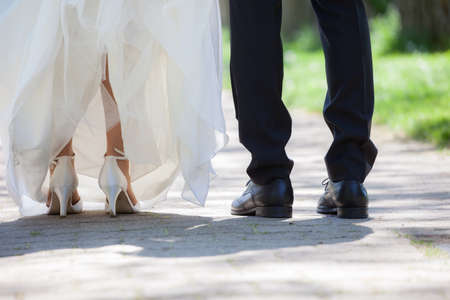 feet of bridgroom and bride photo