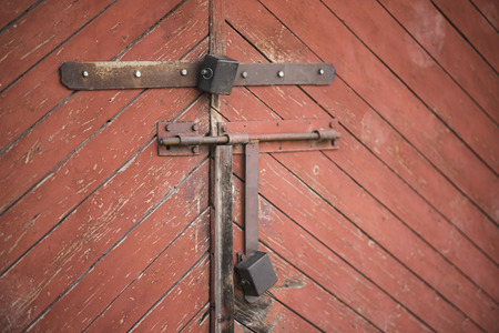 rusty nail: The old door locked with a padlock hanging brackets. Set of backgrounds. Ukraine