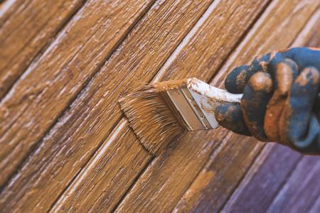Painting wooden door, updates appearance. Preparing for the holidays. Ukraine Archivio Fotografico