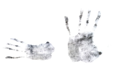 Sample prints of fingers and palms isolated on white background. Example Stock Photo