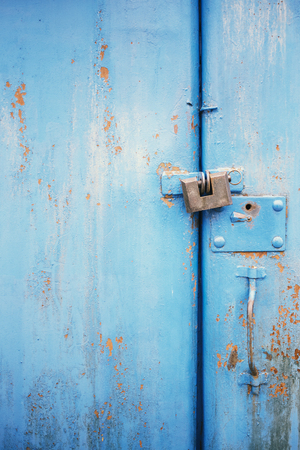 The old door locked with a padlock hanging brackets, set of backgrounds Stock Photo