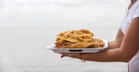 baklava: Honey Baklava on a tray, summer business on the beach, Ukraine