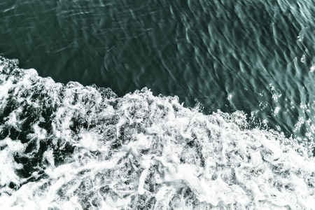 Waves which are caused by ship on the sea, surface divided to areas, place for text