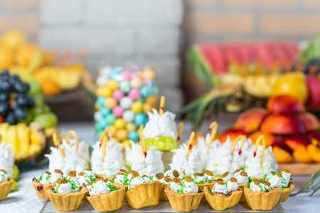 Dessert buffet with baking, sweets, fruits, close up. Catering
