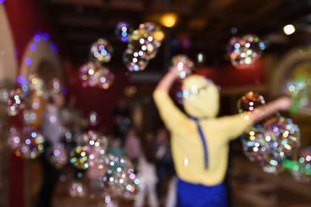 Soap bubble show, birthday party, entertainment for children, blurry background Banque d'images - 97267578