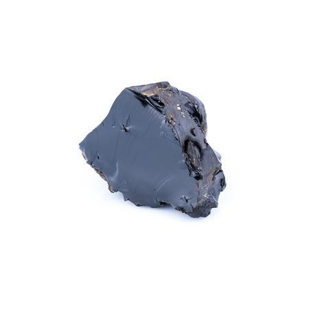 Piece of black resin isolated on a white background, also named how bitumen and asphalt