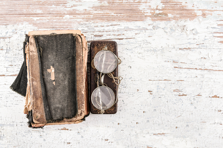 b0711ba0734 Ancient prayer book with round spectacles 1920s and case on the wooden table