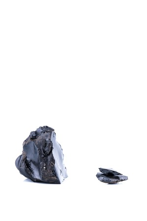 Pieces of black resins isolated on a white background, also named how bitumen and asphalt Stockfoto