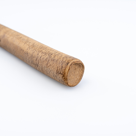 Ebonite stick on white background, with shadows. Also is known as hard rubber or vulcanite Stock Photo