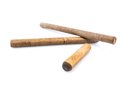 Ebonite stick on white background, with shadows. Also is known as hard rubber or vulcanite. Serves as a material for making decoration or other products Stock Photo - 105620022