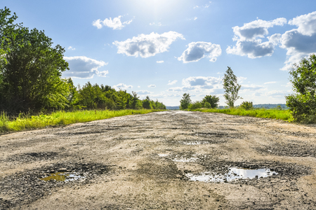 Broken road, potholes and pits. Ukrainian roads