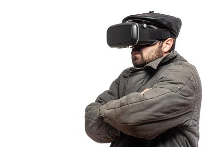 Old fashioned man develops virtual reality headset, studio shot