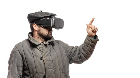 Old fashioned man immersed in virtual reality headset, studio shot, banner with copy space