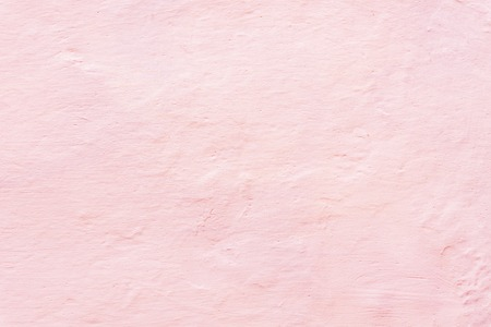 Living coral color textured background, whitewashed wall with color toning