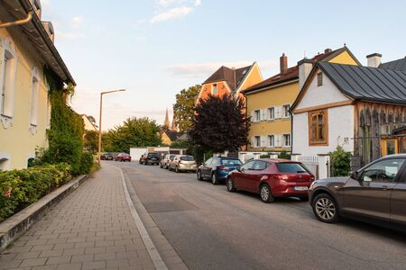 Regensburg, Germany - 26 July, 2018: Clean and cozy streets and architecture of Regensburg city. Many cars on the streets, parking problem.