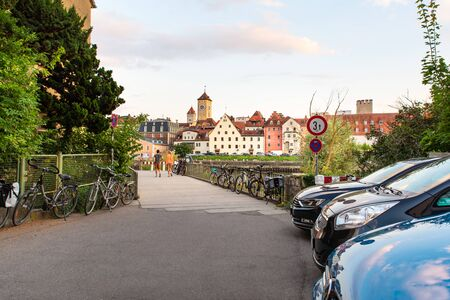 Regensburg, Germany - 26 July, 2018: Streets and architecture of Regensburg city. Monastery and church complex St. Mang in the background.