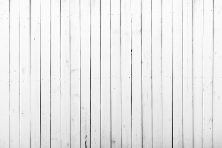 White wooden wall with a lot of cracks, knots and nails. Weathered timber planks, messy and dust, background with rich texture Banco de Imagens