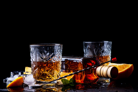 Whiskey on black background, studio shot. Theme of Strong alcohol drinks.