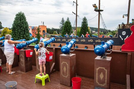 Loifling, Germany - 26 July, 2018: People are having fun shooting from toy guns to each other. Pirates of the Caribbean attraction in Churpfalzpark Loifling - place of entertainment and rest
