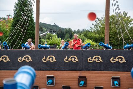 Loifling, Germany - 26 July, 2018: People are having fun shooting from toy cannons. Pirates of the Caribbean attraction in Churpfalzpark Loifling Editorial