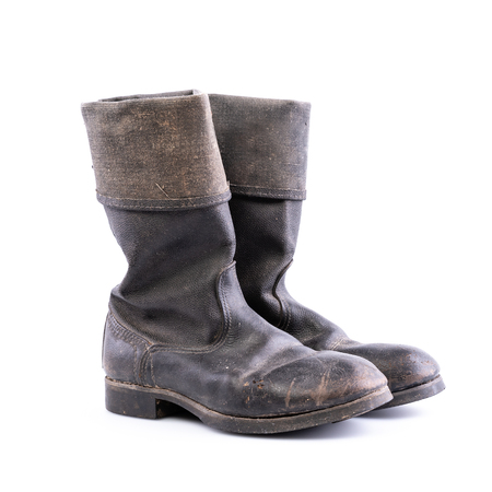 Kirza boots on white background, retro boots, made of artificial leather, used in Soviet Union for soldiers in the army and for work