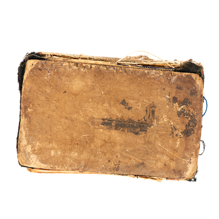 Worn old book, top view. Object isolated on white background with clipping path