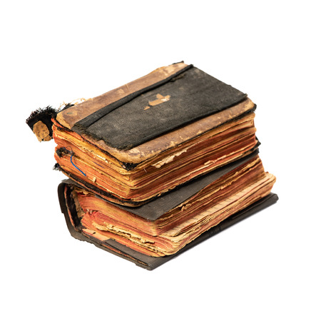 Two ancient prayer books, angle wise, set. Objects isolated on white background with clipping path Stock Photo