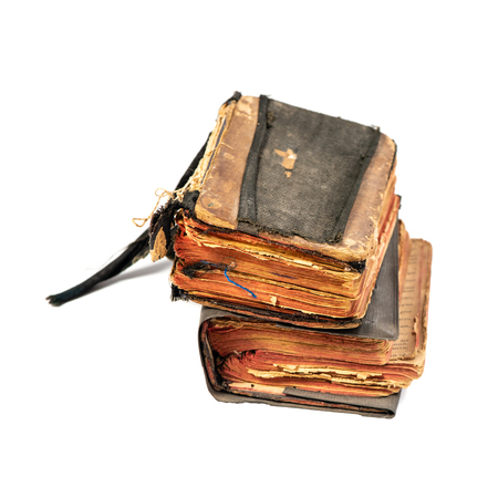 Two ancient prayer books, angle wise. Objects isolated on white background with clipping path Stock Photo