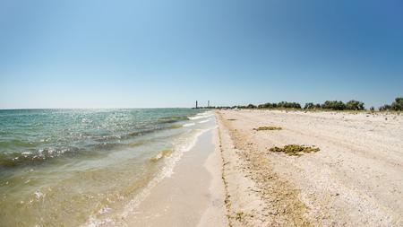 Coast of Dzharylhach island it the Black Sea, Ukraine. Two lighthouses far away Stock Photo