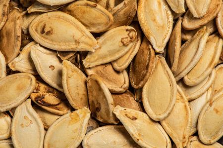 Roasted pumpkin seeds, fried in oven, macro look, top view
