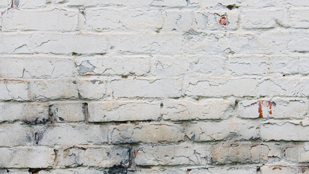 White color brick wall, weathered cracked and dirty, background. Stock Photo