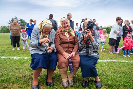 Voroblevychi village, Drohobych district, Ukraine - August 13, 2017: Three older women celebrating the Day of the village. Positive emotions: happy, smiles, laughter and joy