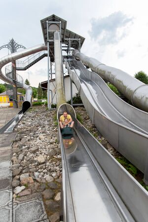 Loifling, Germany - 26 July, 2018: People are having fun on steep slide Rutschenparadies in Churpfalzpark Loifling. Beautiful place for entertainment and rest.