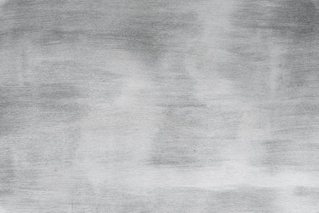 Abstract grunge background. Texture of plaster wall with brush traces, gray color. Interior theme