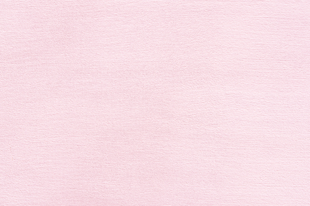 Abstract pink background. Texture of plaster wall with brush traces. Interior theme.