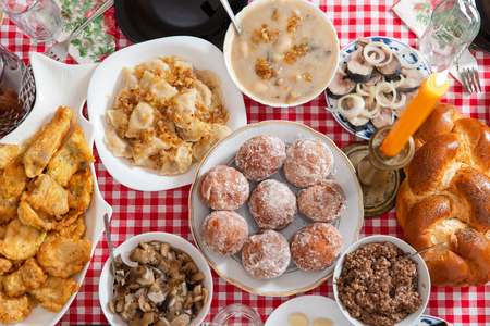 Traditional Christmas table in Ukraine. Twelve dishes: kutya, stewed fruit, dumplings with potatoes and cabbage, pickled mushrooms, donuts, garlic, fried and smoked fish, herring, gravy, beet salad