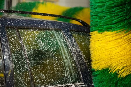 Automatic machine Car Wash with brushes. Car wash service. Caring for a car