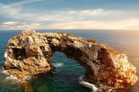 Rocky Arch in the sea, amazing natural wonder. Popular tourist destinations. Mirador Es Pontas, Samtanyi, Palma de Mallorca, Balearic Islands, Spain