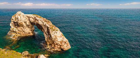 Rocky Arch in the sea. Mirador Es Pontas, Samtanyi, Palma de Mallorca, Balearic Islands, Spain. Popular tourist destinations. Amazing natural wonder Stockfoto