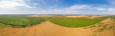 Wide panoramic landscape of farmland, summer time. Aerial view of countryside. Banco de Imagens