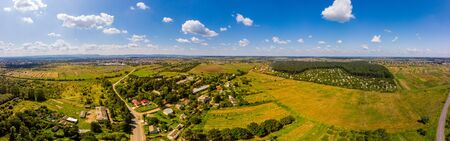 Panoramic landscape of countryside it the west of Ukraine. Aerial drone view of traditional Ukrainian village